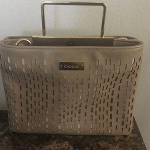 Bebe tan purse with gold tone hardware